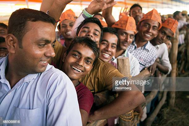 Supporters of the Bharatiya Janata Party stand in line to hear Indian Prime Minister Narendra Modi speak at a rally in Muzaffarpur Bihar India on...