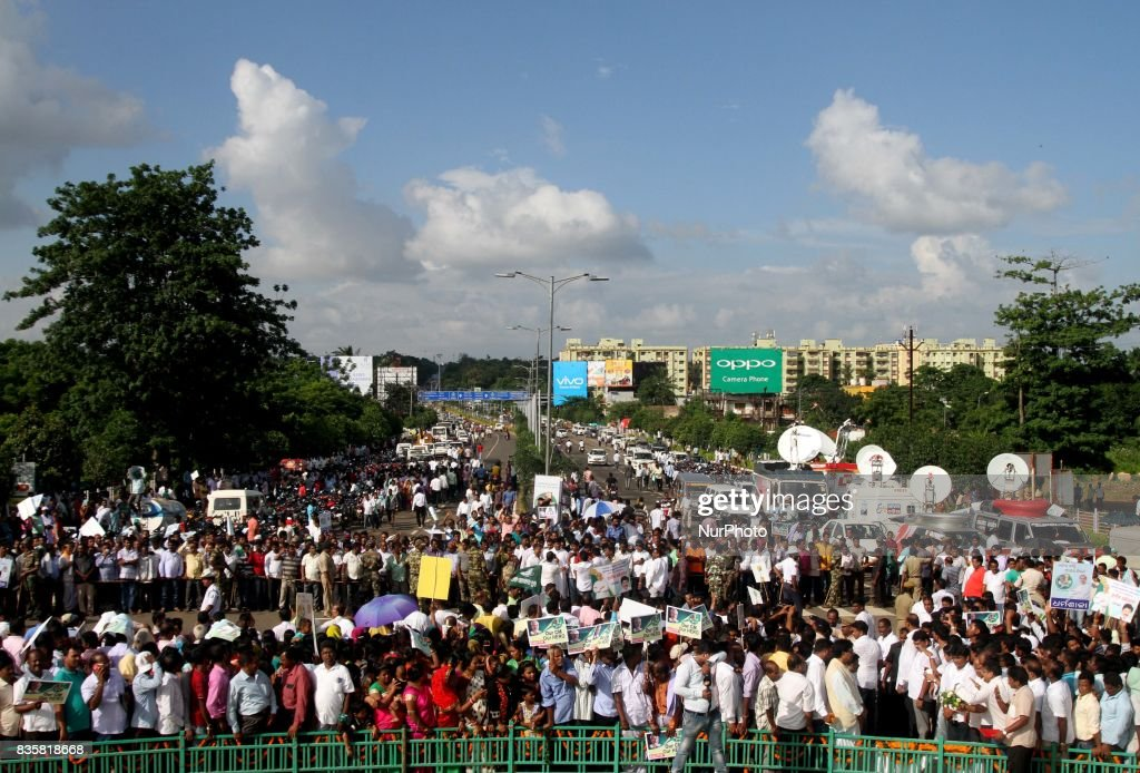 Supporters of the Biju Janata Dal political party stands on wayside outside of the Biju Patnaik International airport, in Bhubaneswar as they wait to welcome the Odisha state chief minister Naveen Patnaik as he arrives at his home town after awarded as the No.1 administrator in India on 20 August 2017.