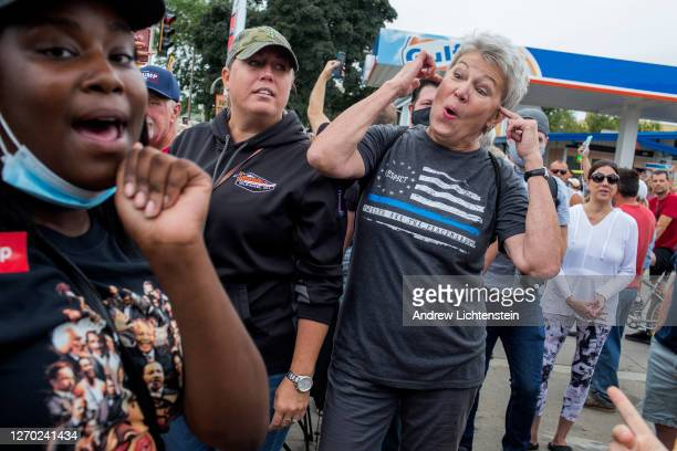 Supporters of the Black Lives Matter movement argue with Trump supporters on the day of President Trump's visit, September 1 in downtown Kenosha,...