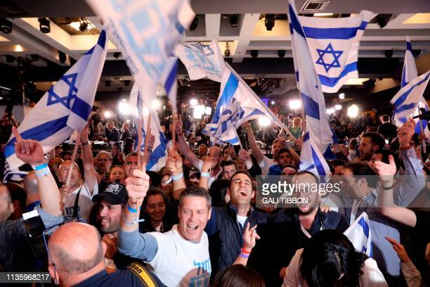 Supporters of the Blue and White political alliance celebrate after watching a tv poll at the alliance headquarters in Tel Aviv on April 9 2019 Prime...
