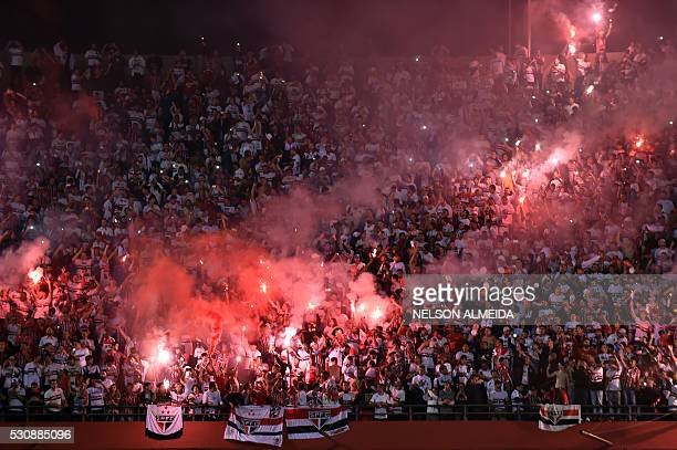Supporters of the Brazilian team Sao Paulo cheer during their 2016 Copa Libertadores quarterfinals first leg football match against Brazils Atletico...