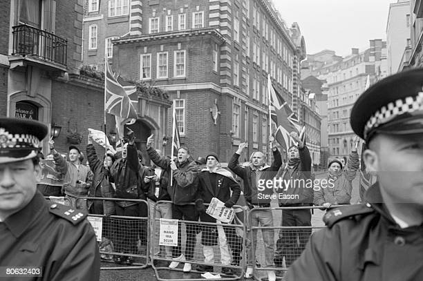 Supporters of the British farright National Front party stage a counterdemonstration during a protest march though London on the 27th anniversary of...