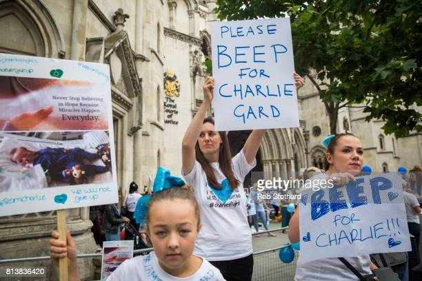 Supporters of the Charlie Gard family gather outside the Royal Courts of Justice on July 13 2017 in London England Charlie's parents Chris Gard and...