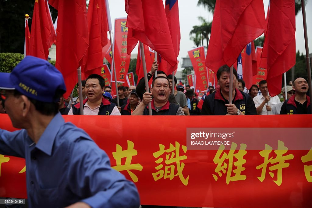 Supporters of the China Unification Promotion Party march and chat ...