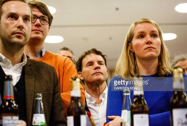 Supporters of the Christian Democratic Union react as first exit polls were announced on public television during the state elections in Hesse at the...