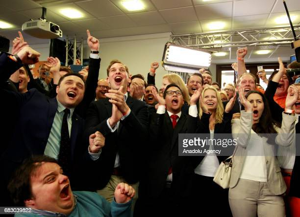 Supporters of the Christian Democratic Union react to the release of first exit poll results indicating 33 % for the CDU and just 30% for the rival...