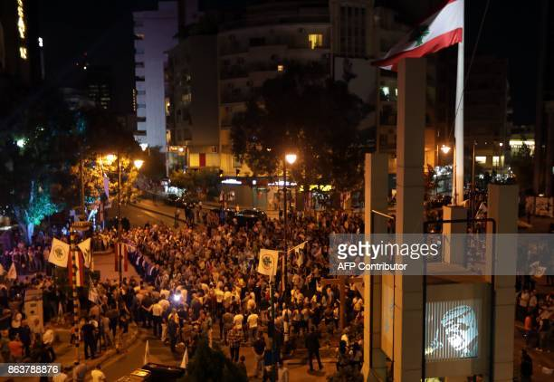 Supporters of the Christian Phalange party and the Lebanese Forces Party gather during a demonstration in the Christian neighborhood of Achrafieh on...