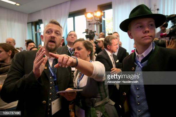 Supporters of the Christian Social Union political party react to initial election results that give the party only 355% of the vote in Bavarian...