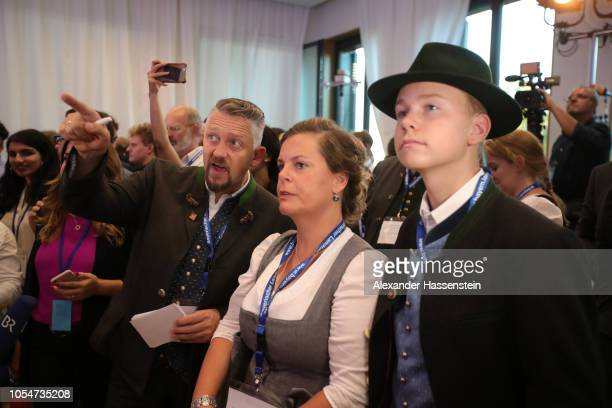 Supporters of the Christian Social Union wait for initial election results in Bavarian state elections on October 14 2018 in Munich Germany Bavaria...