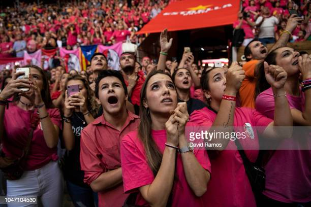 Supporters of the Colla Vella Xiquets de Valls reacts as their colla build a human tower during the 27th Concurs de Castells competition on October 7...