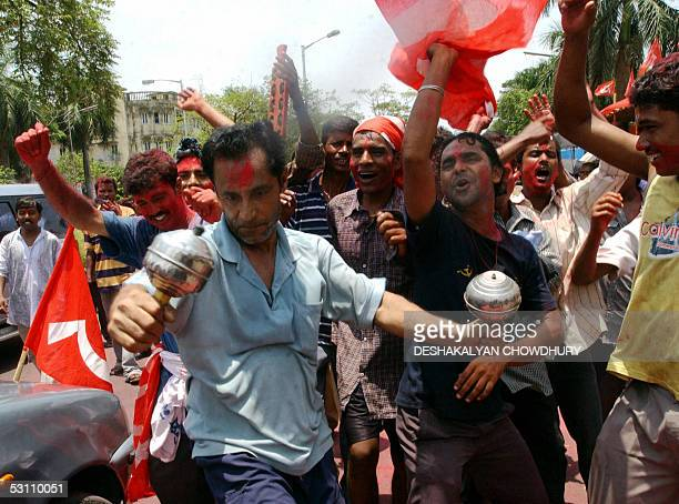 Supporters of the Communist Party of India celebrate their victory in the local municipal elections in Kolkata 21 June 2005 The Communist Partyled...
