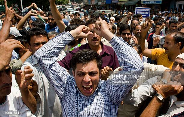 Supporters of the Communist Party of India CPI stage a protest against a price hike in essential commodities on August 2 2012 in Srinagar the summer...