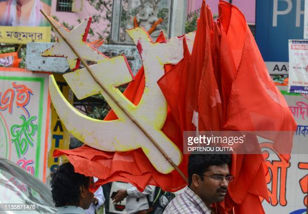 Supporters of the Communist Party of India Marxist take part in an election campaign rally in Siliguri in West Bengal state on April 9 2019 India is...