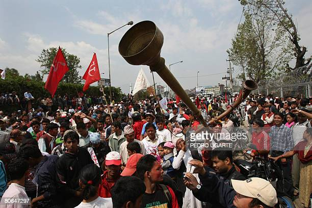 Supporters of the Communist Party of Nepal Maoist celebrate the election of their chairman Pushpa Kamal Dahal known as Prachanda at his constituency...
