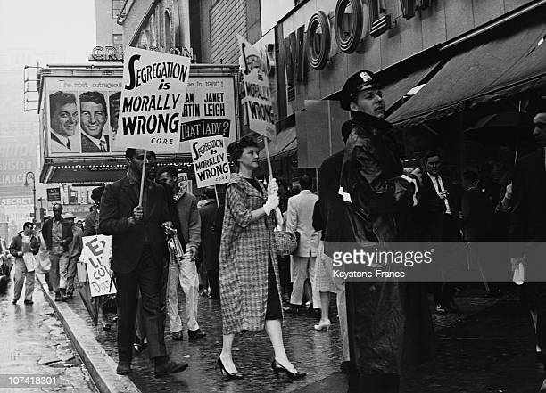 Supporters of the Congress of Racial Equality demonstrate against racial segregation in southern US stores outside a Woolworth's store next to the...