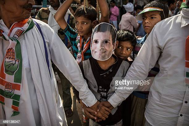 Supporters of the Congress Party's Rahul Gandhi wait for him to pass during a rally on May 10 2014 in Varanasi India India is in the midst of a...