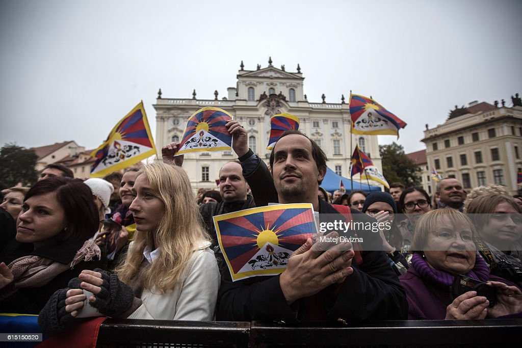 Supporters of the Dalai Lama attend a gathering at the Hradcanske Square in front of Prague Castle on October 17, 2016 in Prague, Czech Republic. It is the first stop during visit of the Dalai Lama to the Czech Republic where he will attend the Forum 2000 Conference.