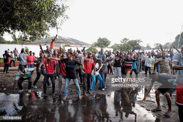 Supporters of the Democratic Republic of Congo's Union for Democracy and Social Progress party demonstrate outside the party headquarters in Kinshasa...