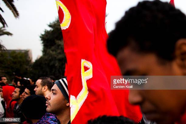 Supporters of the Egyptian Al-Ahly football club attend a demonstration in commemoration of the victims of violence in the stadium in Port Said...