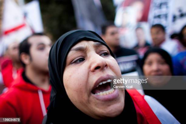 Supporters of the Egyptian AlAhly football club shout slogans during a demonstration in commemoration of the victims of violence in the stadium in...