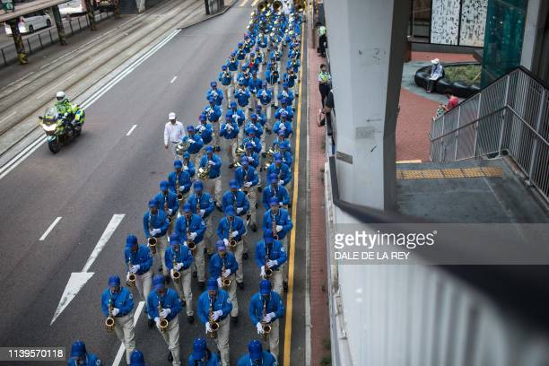 Supporters of the Falungong spiritual movement a group banned in mainland China take part in a march in Hong Kong on April 27 to observe the 20th...