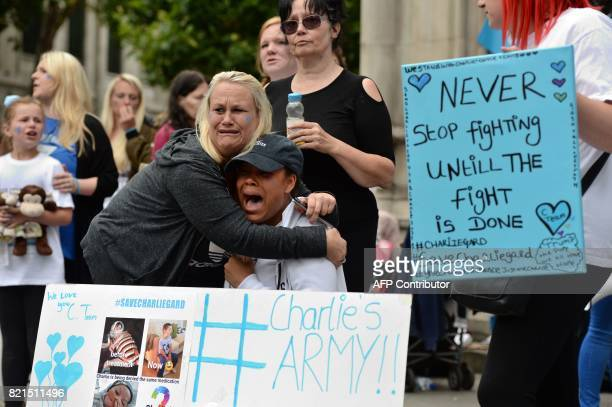 Supporters of the family of terminallyill British baby Charlie Gard react after the announcement that his parents have abandoned their legal fight to...
