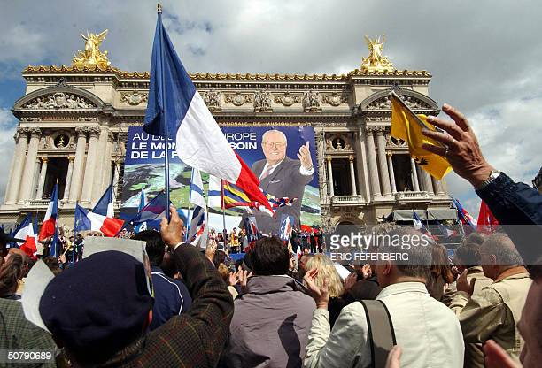 Supporters of the far right National Front listen to their leader JeanMarie Le Pen speaking at the end of the FN rally in tribute to Jeanne d'Arc 01...