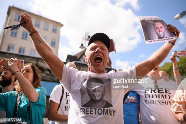 Supporters of the Far-right activist Tommy Robinson react after hearing of his release on bail after appealing against a charge of contempt of court,...