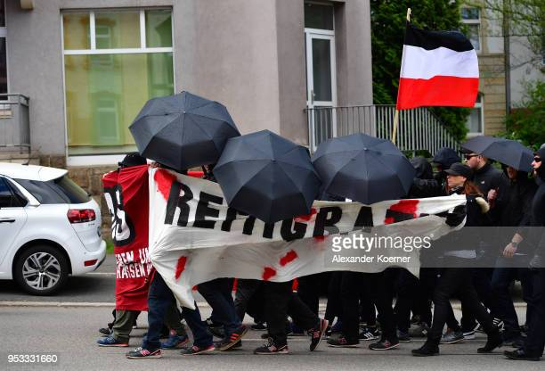 Supporters of the far-right NPD political party gather to march on May Day on May 1, 2018 in Erfurt, Germany. The NPD has seen a sharp decline in its...