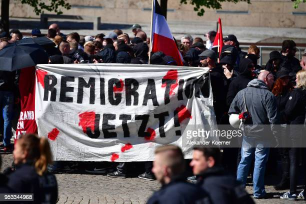 Supporters of the farright NPD political party march on May Day on May 1 2018 in Erfurt Germany The NPD has seen a sharp decline in its support base...