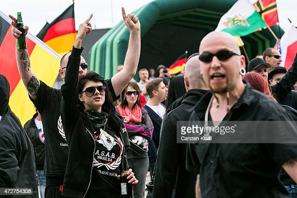 Supporters of the farright NPD political party shout slogans as they gather near the Reichstag to protest against what they call the Islamization and...