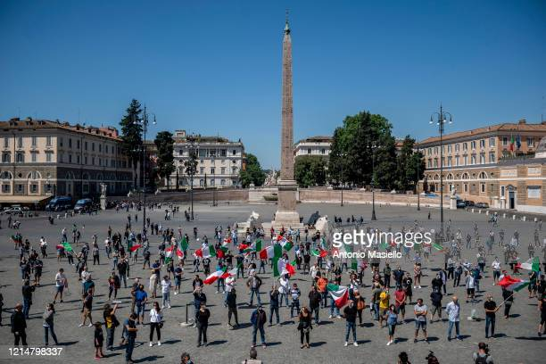 Supporters of the far-right political movement CasaPound, wearing protective masks with the Italian tricolor, take part in a demonstration to protest...