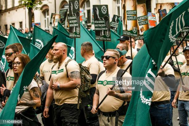 Supporters of the farright The Third Way movement march on May Day on May 1 2019 in Plauen Germany In Saxony which is to hold state election this...