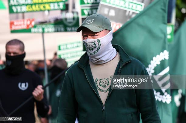 Supporters of the far-right Third Way neo-Nazi political party march on the 30th anniversary of German reunification in Hohenschoenhausen district on...