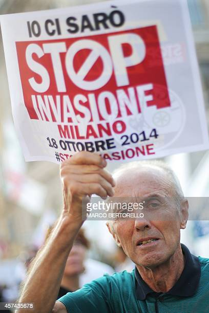 Supporters of the federalist and regionalist Italian political party Lega Nord and farright activists hold posters reading Stop Invasion during a...