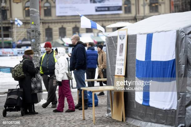 Supporters of the 'Finland First' movement are seen close to a temporary refugee protest camp at the Central railway station in Helsinki Finland on...