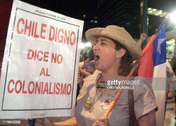 Supporters of the former Chilean dictator Augusto Pinochet celebrate near the embassies of Great Britain and Spain 11 January 2000 in Santiago Chile...