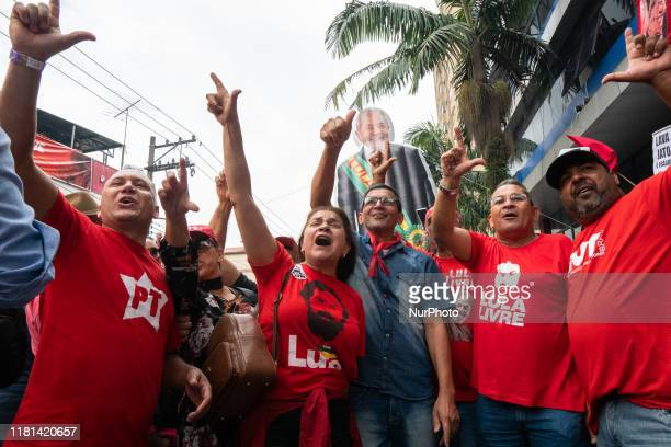Supporters of the former President Luiz Inacio Lula da Silva gesture in support of his freedom while awaiting his appearance in front of ABC...