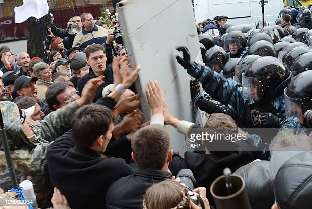 Supporters of the former Prime Minister Yulia Tymoshenko break a police fence in front of Pechersk district court in Kiev on October11 2011 A...