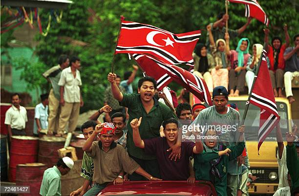 Supporters of the Free Aceh Movement celebrate the 23rd anniversary of their independence movement December 7 1999 in Indonesia's northernmost...