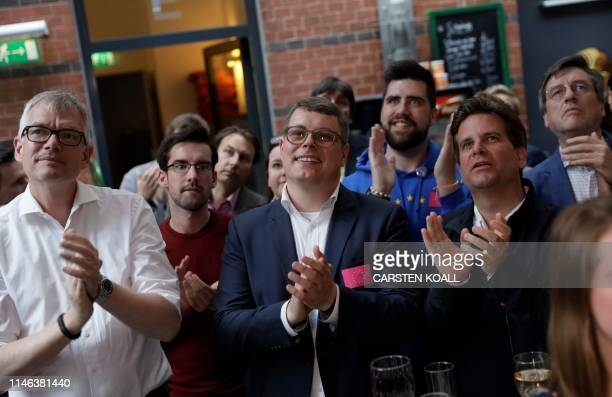 Supporters of the Free Democratic Party react after the first results in the European parliament elections on May 26, 2019 in Berlin. - Europeans...
