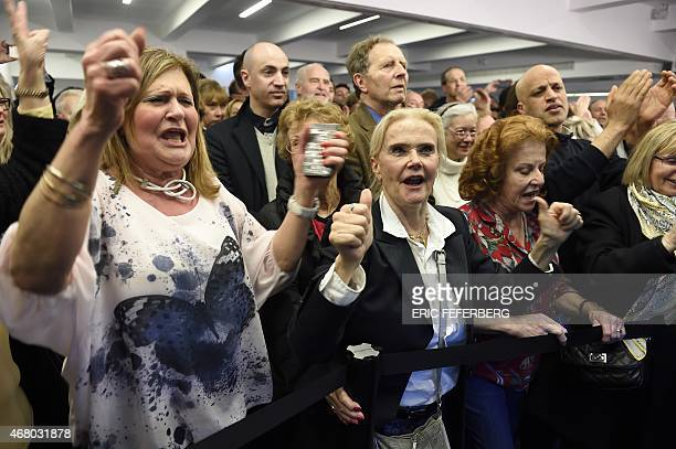 Supporters of the French UMP party celebrate after the anouncement of results of the French departementales elections on March 29 2015 in UMP...
