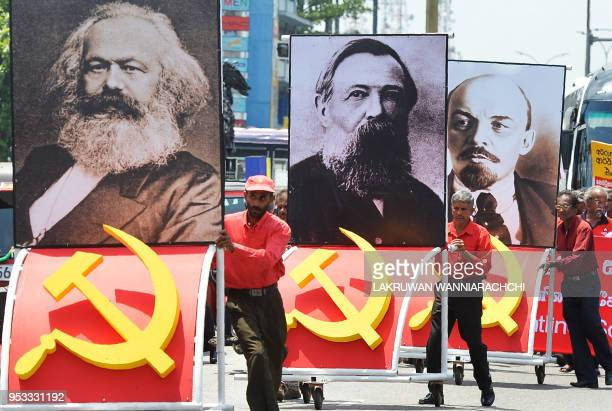 Supporters of the Frontline Socialist Party display placards with the images of Karl Marx Friedrich Engels and Vladimir Lenin as they take part on a...