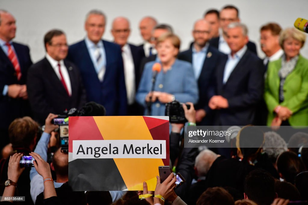 Supporters of the German Christian Democrats (CDU), the party of German Chancellor Angela Merkel, react to initial results that give the party 33% of the vote, giving it a first place finish, in German federal elections on September 24, 2017 in Berlin, Germany. Chancellor Merkel is seeking a fourth term and coming weeks will likely be dominated by negotiations between parties over the next coalition government.