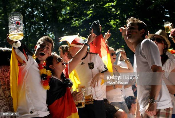 Supporters of the German football team celebrate during the 2010 FIFA World Cup quarter final match between Germany and Argentina at a beer garden on...