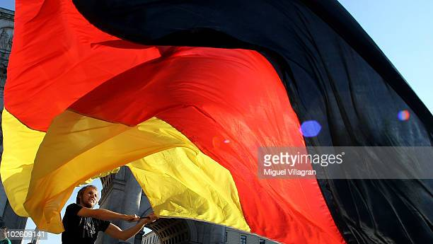 Supporters of the German football team celebrate Germany's victory on the streets after the 2010 FIFA World Cup quarter final match between Germany...