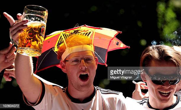 Supporters of the German football team celebrate prior to the 2010 FIFA World Cup quarter final match between Germany and Argentina at a beer garden...