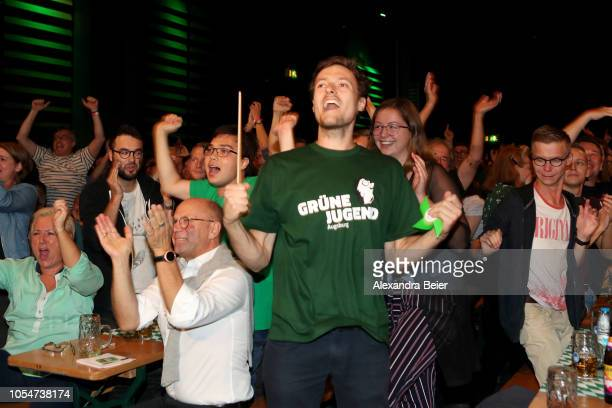 Supporters of the German Greens Party react to initial election results that give the party 185% of the vote in Bavarian state elections on October...