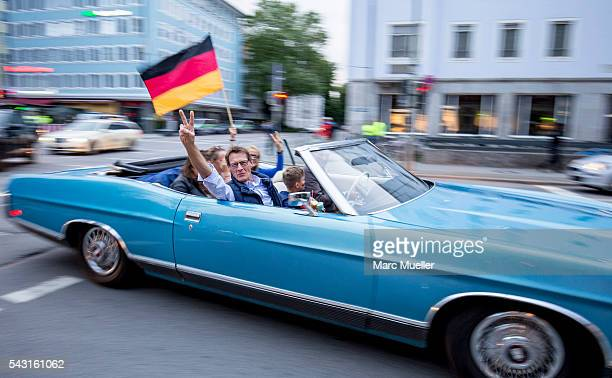 Supporters of the German national football team celebrate after winning the match against Slovakia during the UEFA EURO 2016 at Leopold Street on...