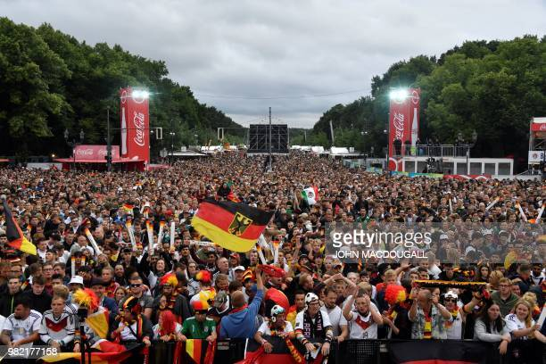 Supporters of the German national football team cheer during a public viewing event prior to the opening whistle of the Russia 2018 World Cup Group F...